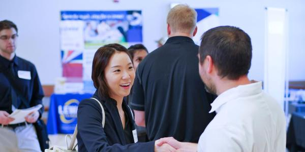 Student shaking hands at Career Fair