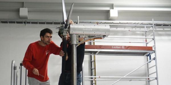 People working on wind turbine
