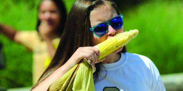 Girl eating an ear of corn