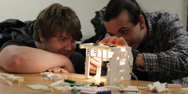 Two students work on a Lego lighting project during their architectural lighting design class