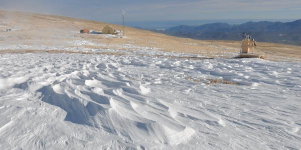 INSTAAR research on snow covered hillside
