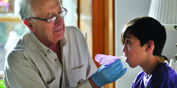 Child being administered a measles vaccine