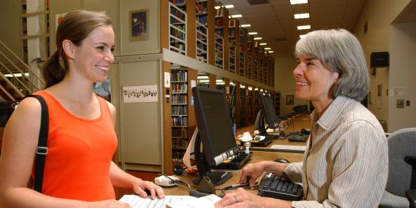 Student checking out at Music Library