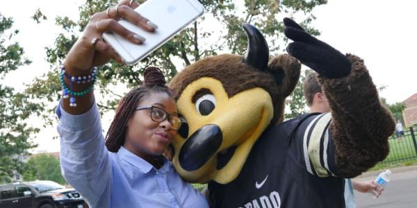 Student taking a selfie with Ralphie