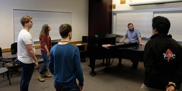 Faculty and students in music class