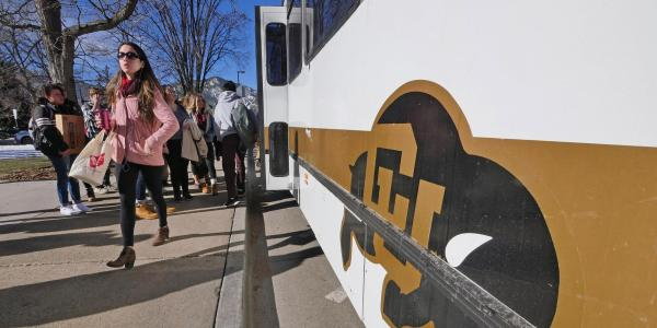Students taking campus bus
