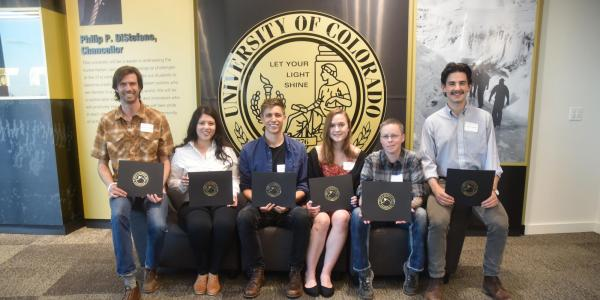 Students holding writing awards