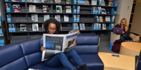 Student reading in the Business Library