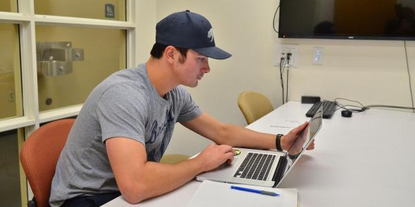 Student on laptop in Business Library
