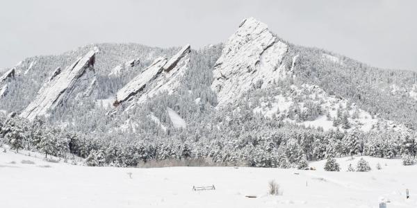 The Flatirons covered in snow