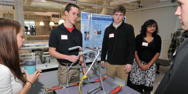 Group of engineers around a model
