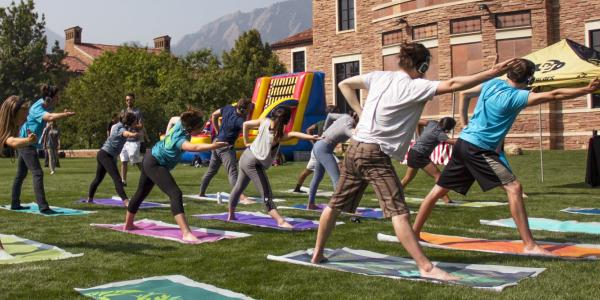 Students doing yoga on Farrand Field