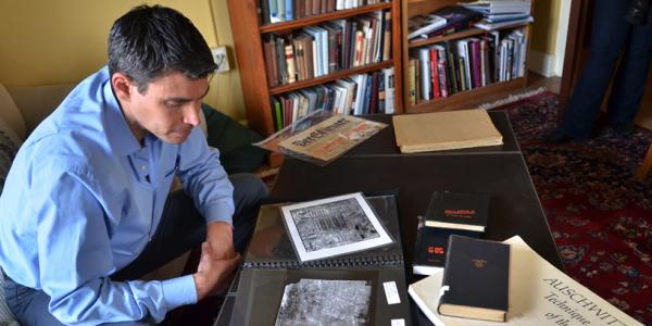 Man studying copies of Jewish artifacts