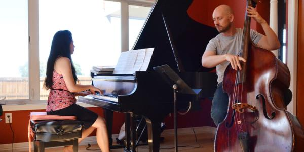 Woman playing the piano and a man playing the cello