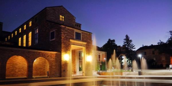 CU Boulder building at night