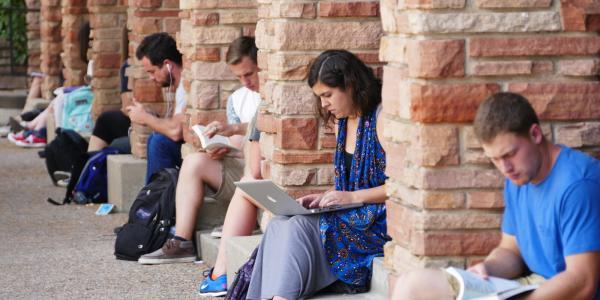 Students studying outside the UMC building