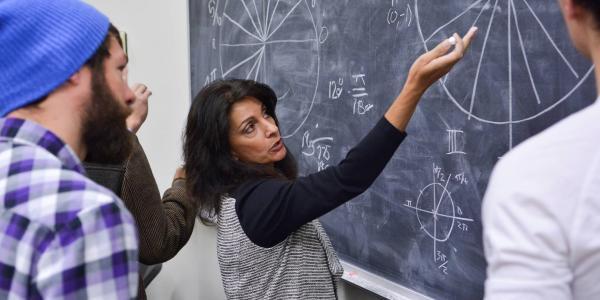Professor explaining math problem