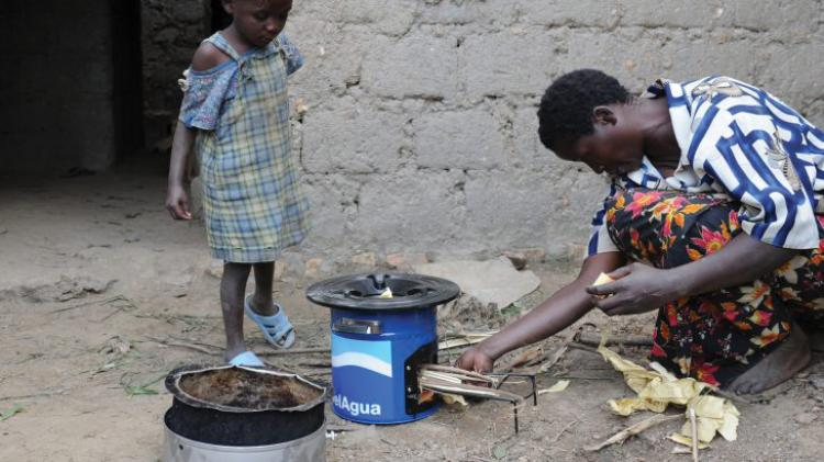 Rwandan family with biomass-burning cookstove
