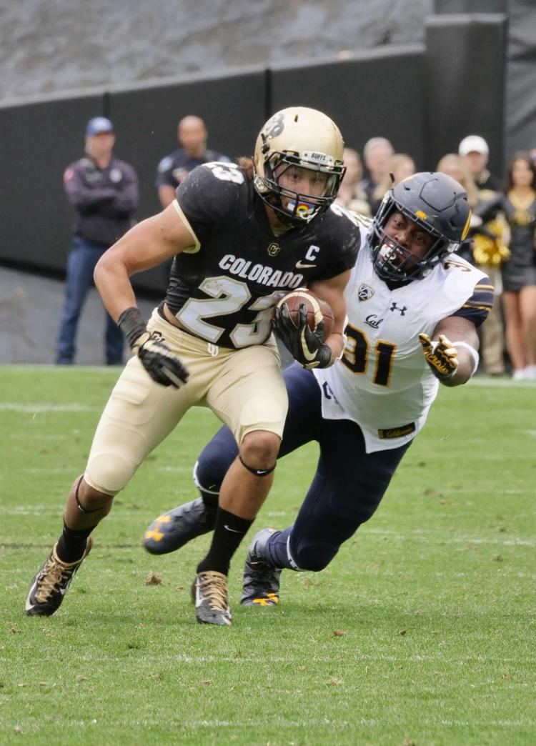 CU Boulder football player in action
