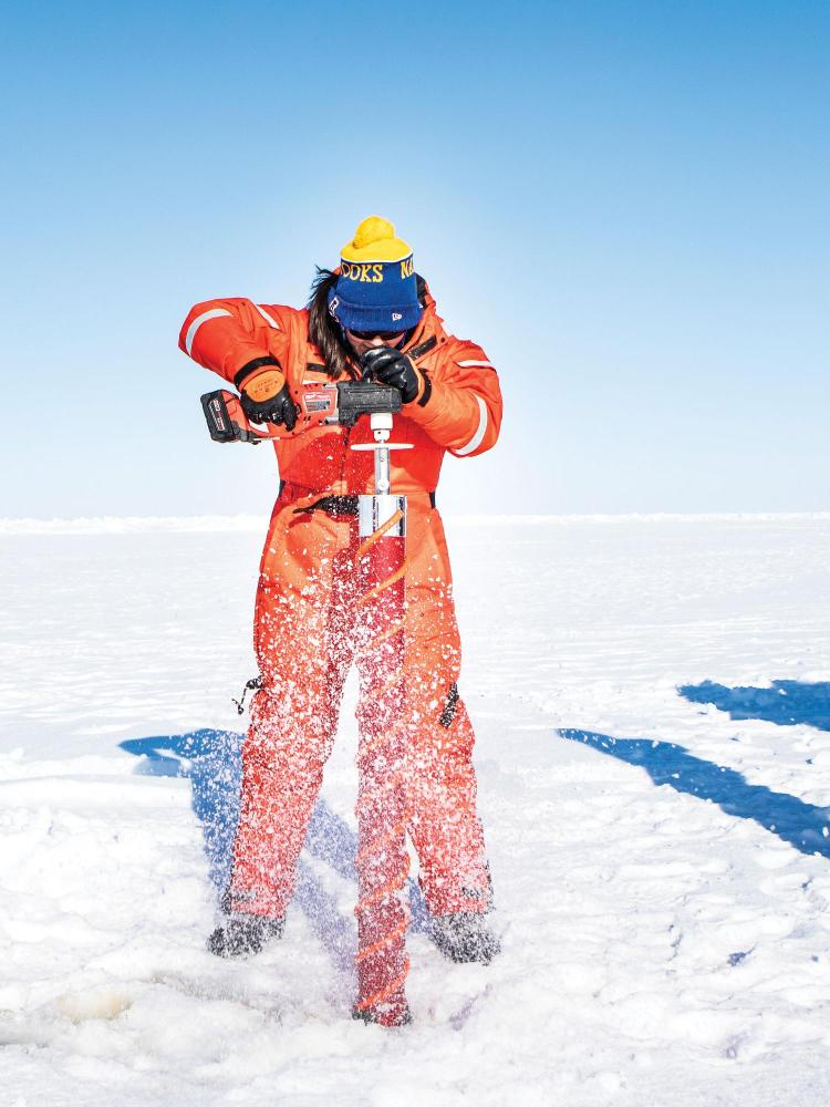 Researcher drilling in the arctic