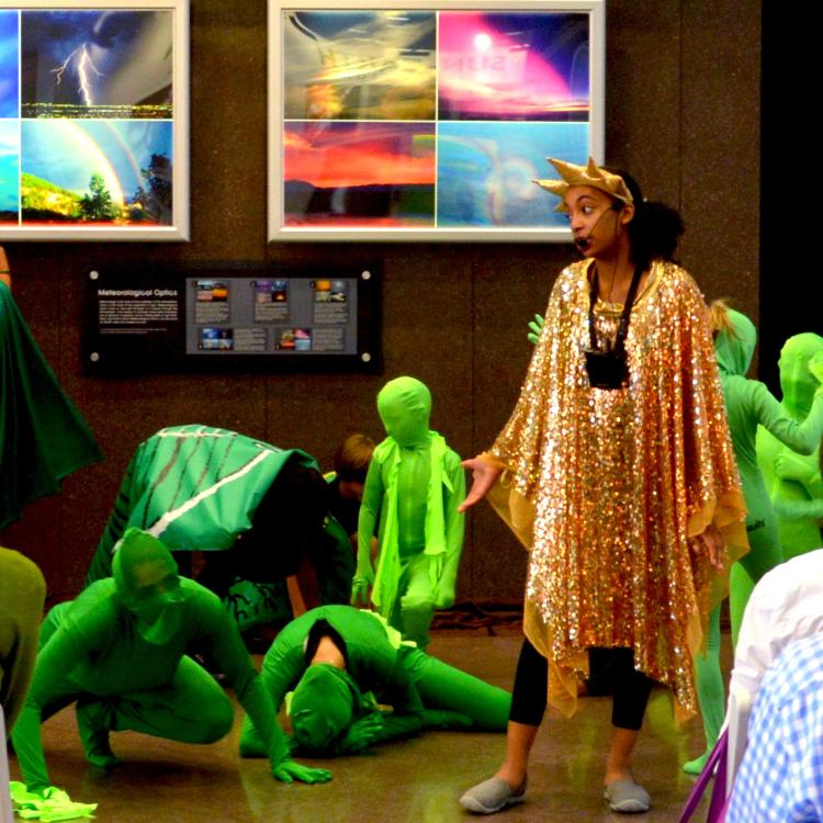 Kids perform for scientists in the lobby of NCAR in Boulder