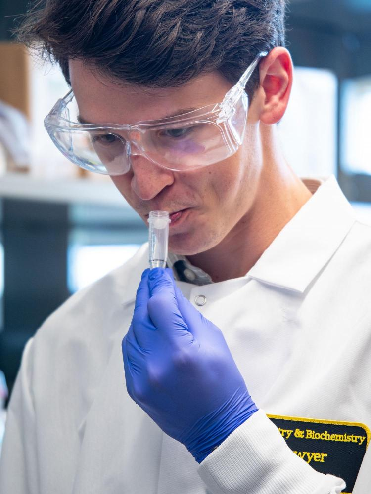 Researcher drools saliva into a tube