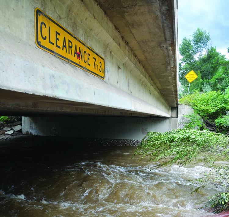 Boulder Creek overflowing its banks during the 2013 flood, under the bridge