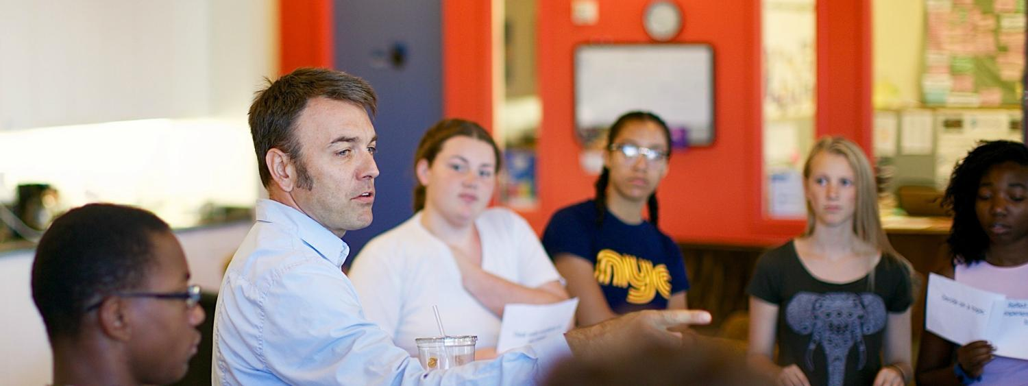 Ben Kirshner, CU Engage faculty director and co-principal investigator in the new research hub, works with Denver youth, who are involved in the educational justice movement at Project VOYCE.