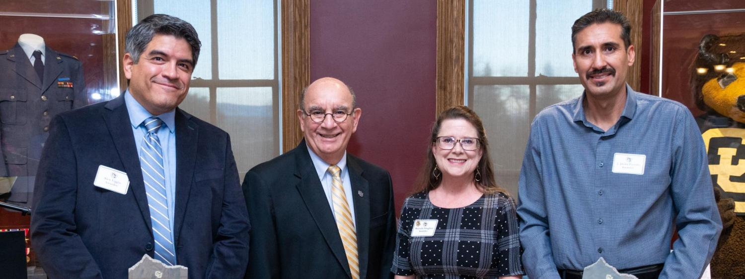 CU Boulder Chancellor Phillip DiStefano, center left, stands with winners of the 2019 Chancellor's Employee of the Year Award. (Photo by Patrick Campbell/University of Colorado)