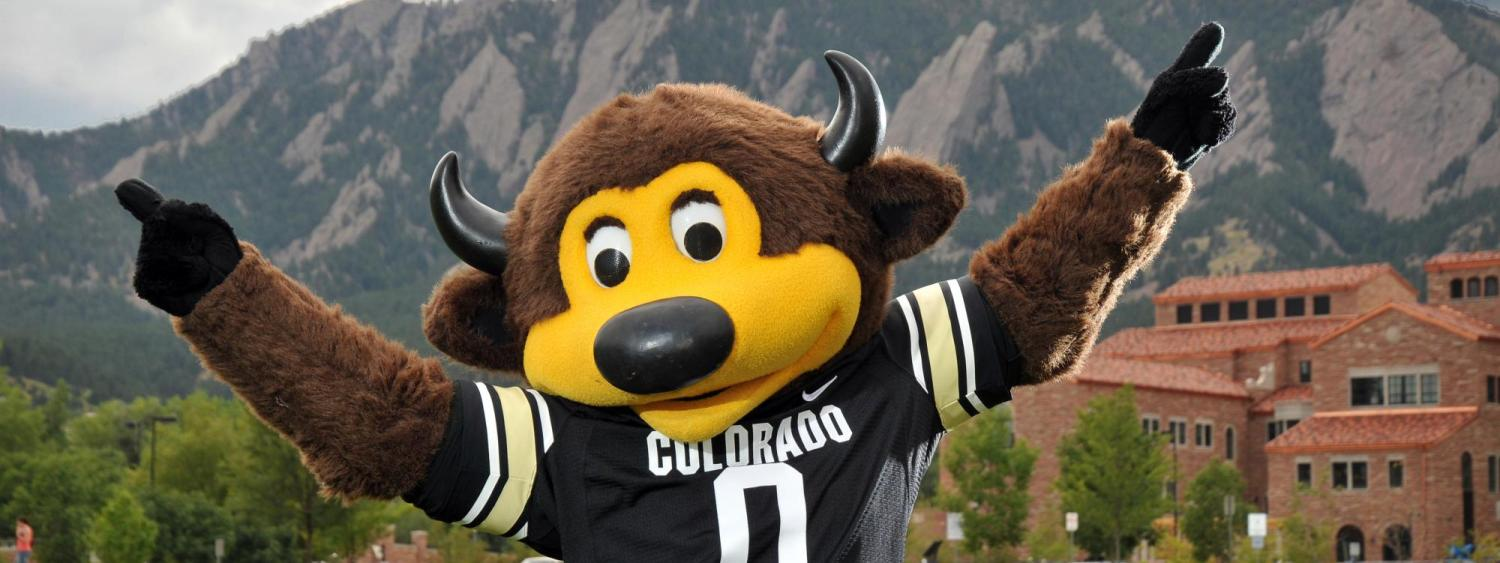 Mascot Chip in front of the Flatirons