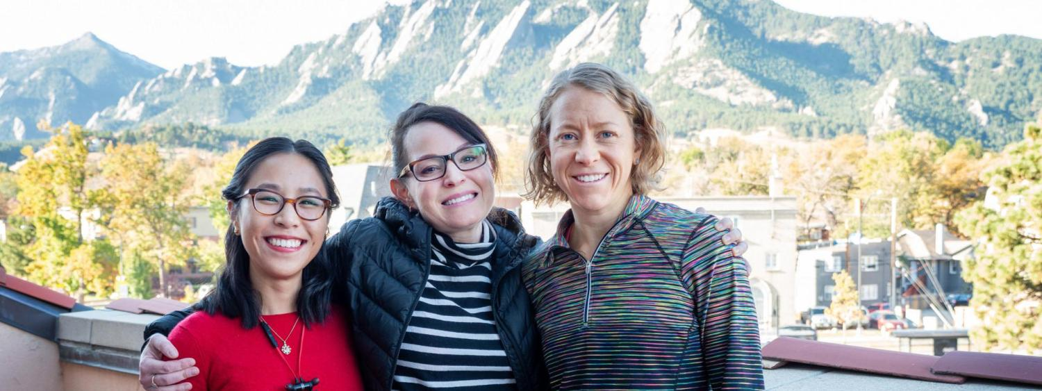Three women (Huang, Blood, Connor) in front of the flatirons