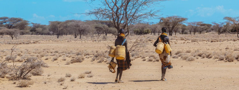 Two people collect water in Turkana, Kenya