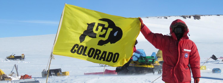 Brian Hynek with CU Boulder flag
