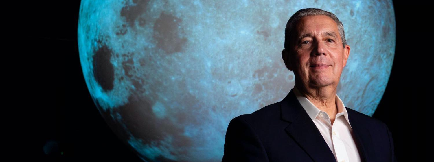 Jack Burns in front of a large moon
