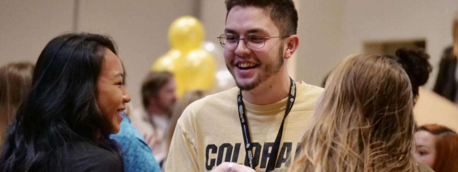 Sean Rodriguez, a computer science major from Illinois, visits with other incoming students during the spring 2018 New Student Welcome Day.