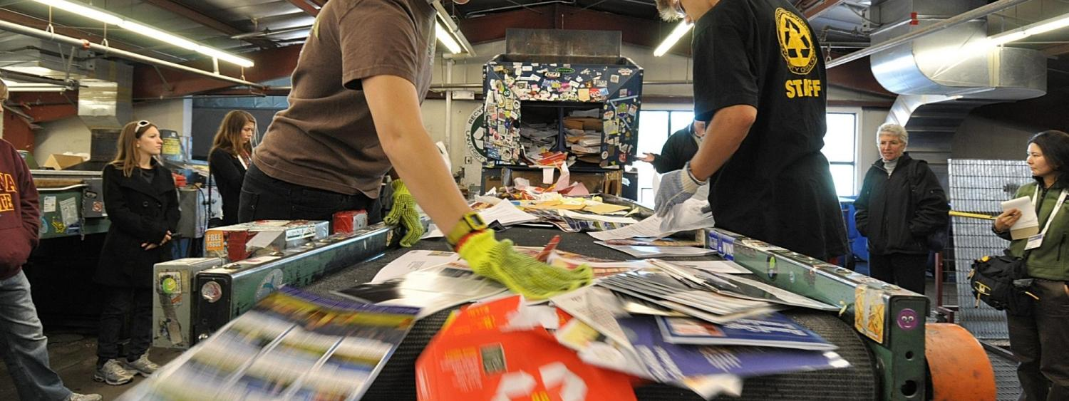 Students work at Recycling Center during campus sustainability tour