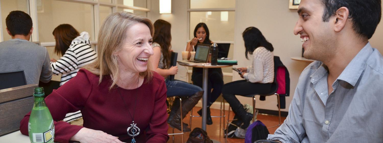 Sharon Matusik talks with a student