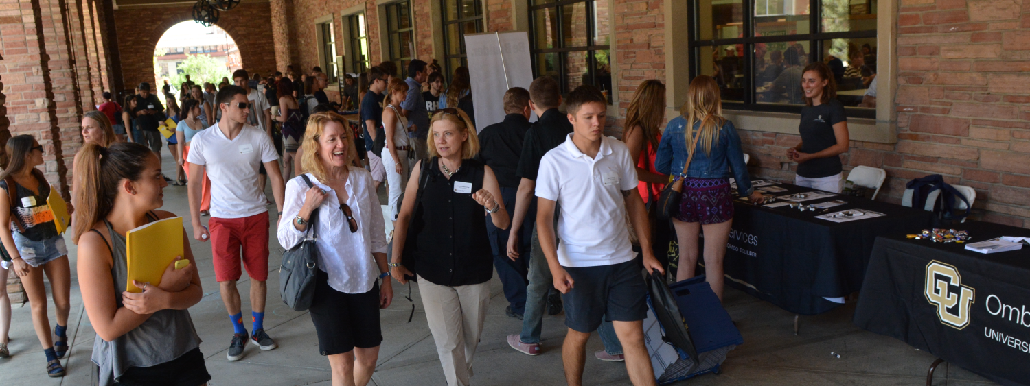 Students and parents walking through breezeway outside the UMC
