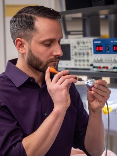 Mark Rentschler holding Endoculus device