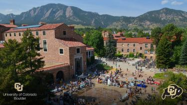 Aerial of the Dalton Trumbo fountain at the UMC with students
