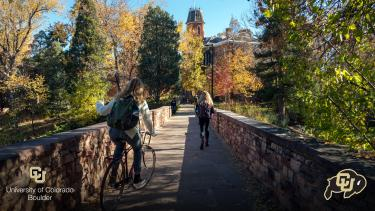 Students on the bridge over Varsity Pond