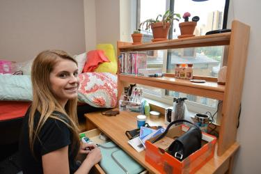 Student in her dorm room
