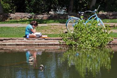 Student sitting next to bike
