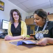 Student working with international admissions counselor