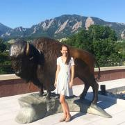 Alexa in front of a buffalo statue