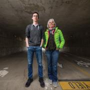 Martha Russo and Bruce Price in an pedestrian underpass