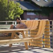 Man sitting on unique picnic table