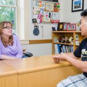 Advisor with student