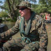 U.S. Marine Corps escorting the community on rafts