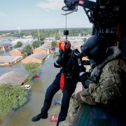 Rescuer lowered from helicopter over Houston flooding